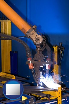 an industrial welding robot - with Wyoming icon